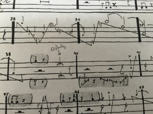 (Sheet music that looks barely like piano music)